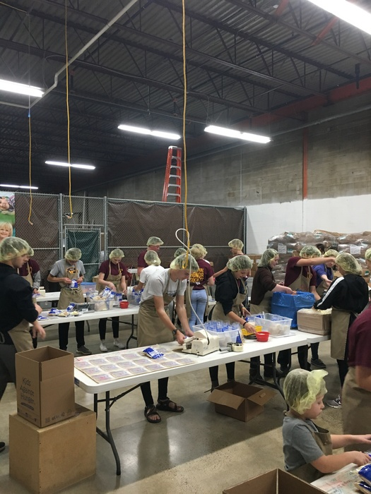 Members packing meals