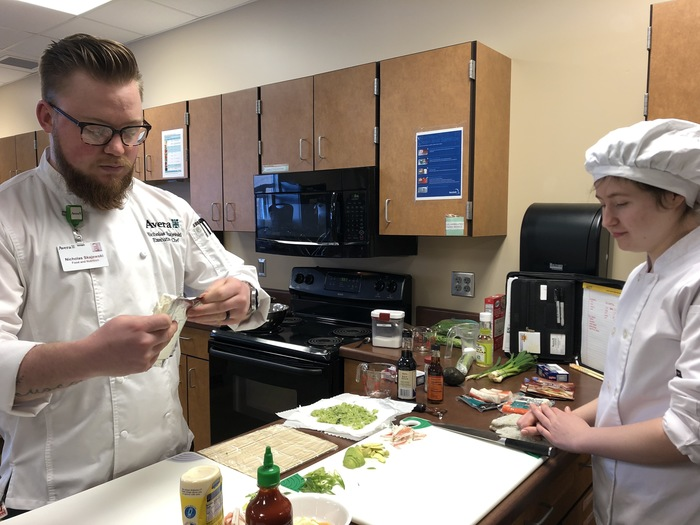 Chef Nicholas working with Culinary Arts II students