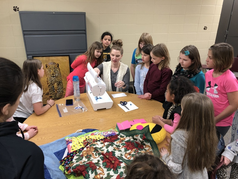 Freedom students learn about sewing